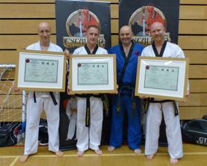 The Three Amigos are presented with their Black Belt Dan Grading Certificates by Excalibur Martial Arts Chief Instructor, Mr McGinley, 5th Dan